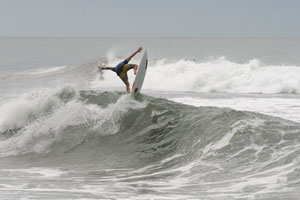Thomas Lange launching of a wave in Hermosa.