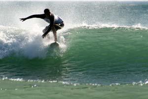 Surfing at Playa Avellanas, Guanacaste.