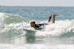 Catching a small wave in Playa Avellanas.