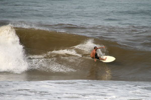 Surfing a left at Backyards.