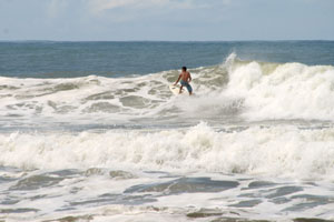A shortboarder surfing in Dominical.