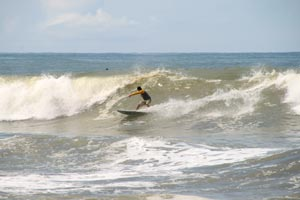 Surfing the beach break of Dominical.