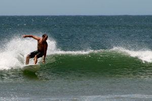 Surfing small waves in Tamarindo.