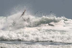 A surfer making use of the whitewater.