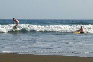 Learning to surf wihte water with a surf instructor.
