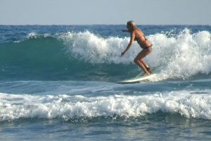 Surfing a small right hander.