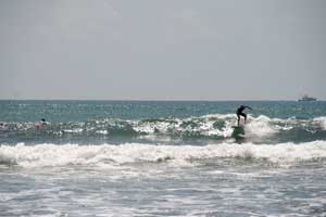 Surfer on a minimalibu in Esterillos Oeste, Costa Rica.