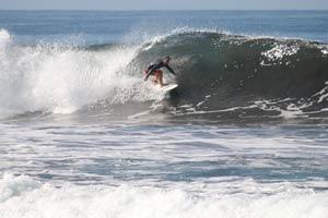 Surfing a nice left hander.