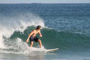 Surfing a small wave during a morning session with an offshore breeze.