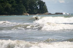 Surfing at Playa Dominicalito.