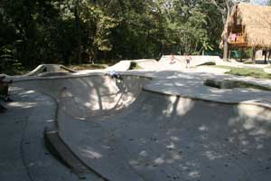 Flow style skatepark with a nice big bowl.