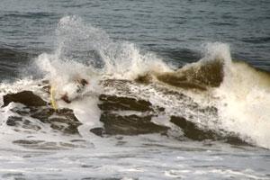 Throwing spray at Playa Hermosa.