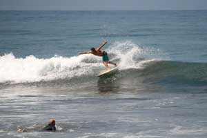 Surfer having fun in a small wave in Jaco.
