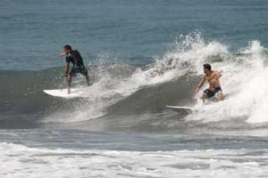 Two surfers on a small right.