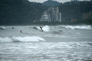 A surfer on mushy waves during the rainy season.