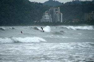 A surfer on mushy waves during the rainy season.